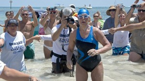 Diana Nyad emerges from the Atlantic Ocean after completing a 111-mile swim from Cuba to Key West, Fla. Andy Newman/Florida Keys Bureau/AP Photo