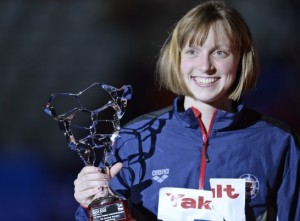 Katie Ledecky of Bethesda, with the FINA Best Female Swimmer trophy after winning four golds at the world championships in Barcelona in August, was named the USOC Sportswoman of the Year - Manu Fernandez/Associated Press