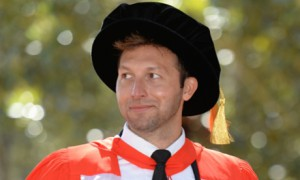 Olympian Ian Thorpe dons university robes to pick up an honorary doctorate from Macquarie University. Photograph: (AAP Image )