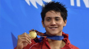 Gold medallist Singapore's Joseph Isaac Schooling poses with his medal on the podium during the victory ceremony for the men's 100m butterfly swimming event during the 17th Asian Games at the Munhak Park Tae-hwan Aquatics Centre in Incheon on Sept 24, 2014.  (AFP)