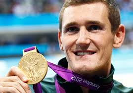 Cameron van der Burgh of South Africa smiles with his gold medal during the men's 100m breaststroke victory ceremony at the London 2012 Olympic Games (reuters)