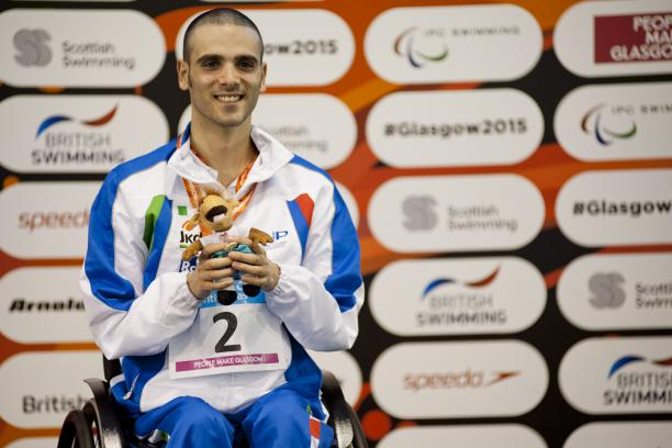 Vincenzo Boni of Italy on the podium after the Men's 50m Backstroke S3 at the 2015 IPC Swimming World Championships in Glasgow. (Luc Percival Photography)