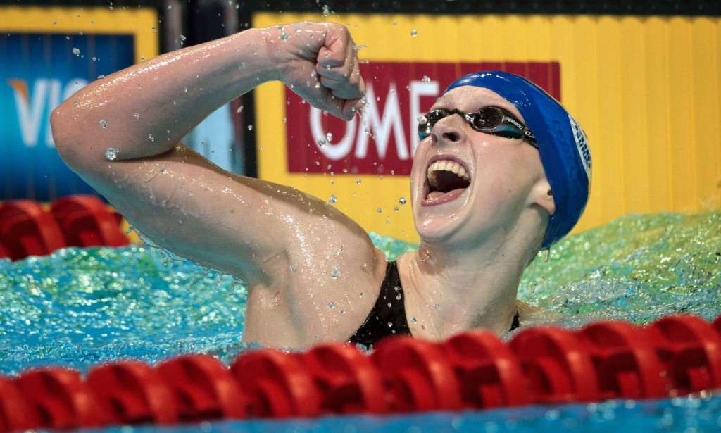 Then-15-year-old Katie Ledecky celebrates her win in the 800 meter freestyle final in the CenturyLink Center on July 1, 2012. (Matt Miller)