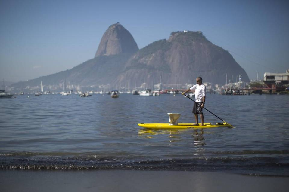 A protester paddles with a toilet atop his board during a demonstration on Botafogo Beach, in the Guanabara Bay in Rio de Janeiro in 2015, near where Olympic sailing events are to be held. Felipe Dana The Associated Press