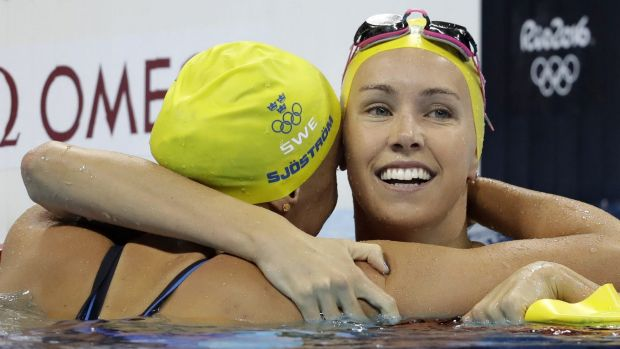 Missing out: Emma McKeon (right) congratulates Sweden's gold medal winner Sarah Sjostrom after the Swede set a world record in the women's 100-metre butterfly final in Rio. Photo: AP