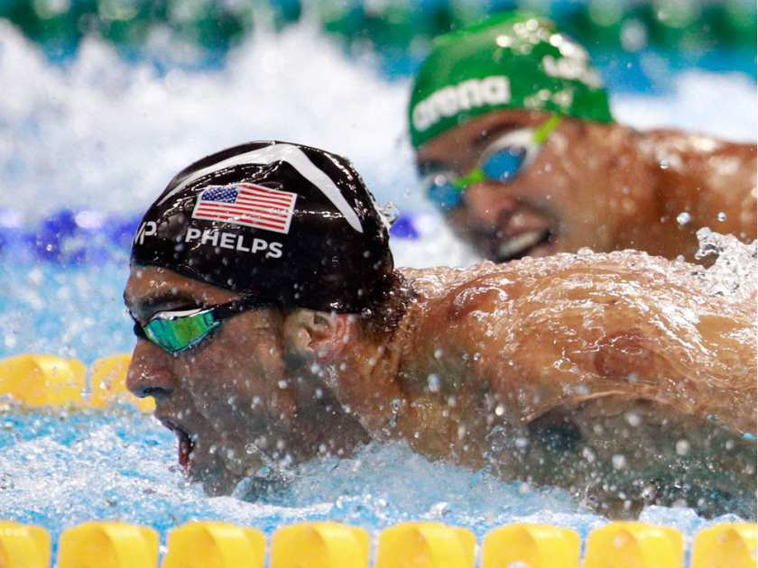 Michael Phelps, left, of the United States leads Chad le Clos of South Africa in the men's 200m butterfly final on Day 4 of the Rio 2016 Olympic Games at the Olympic Aquatics Stadium on Aug. 9, 2016 in Rio de Janeiro, Brazil. Adam Pretty / GETTY