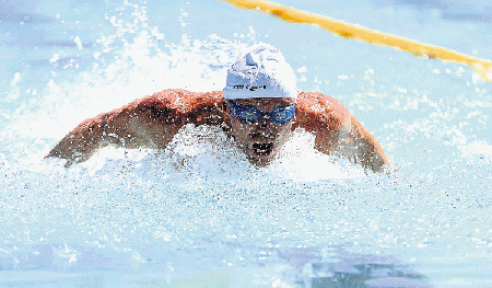 POWERING HOME: Mike Sample, 60, from East Gauteng motors to the finish line at the South African Masters swimming championships Picture: SIBONGILE NGALWA