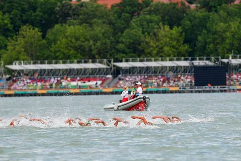 Swimmers compete in the men's open water 5km final of FINA Swimming World Championships 2017 in Balatonfured, 124 kms southwest of Budapest, Hungary, Saturday, July 15, 2017. MTI via AP Zsolt Szigetvary