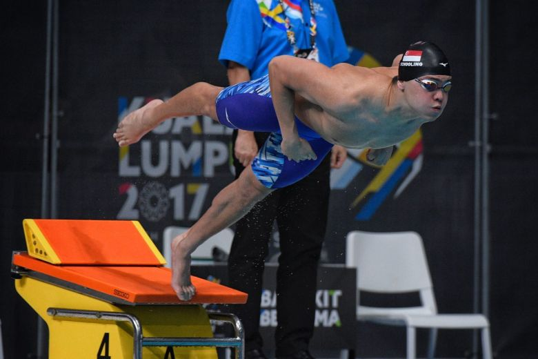 Singapore's Joseph Schooling leaping from the starting blocks during the men's 50m butterfly final at the SEA Games on Aug 21, 2017. (MARK CHEONG)