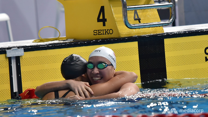 Singapore's Roanne Ho celebrates winning gold in the SEA Games 50m breaststroke final on Tuesday (Aug 22). (Photo: Noor Farhan)