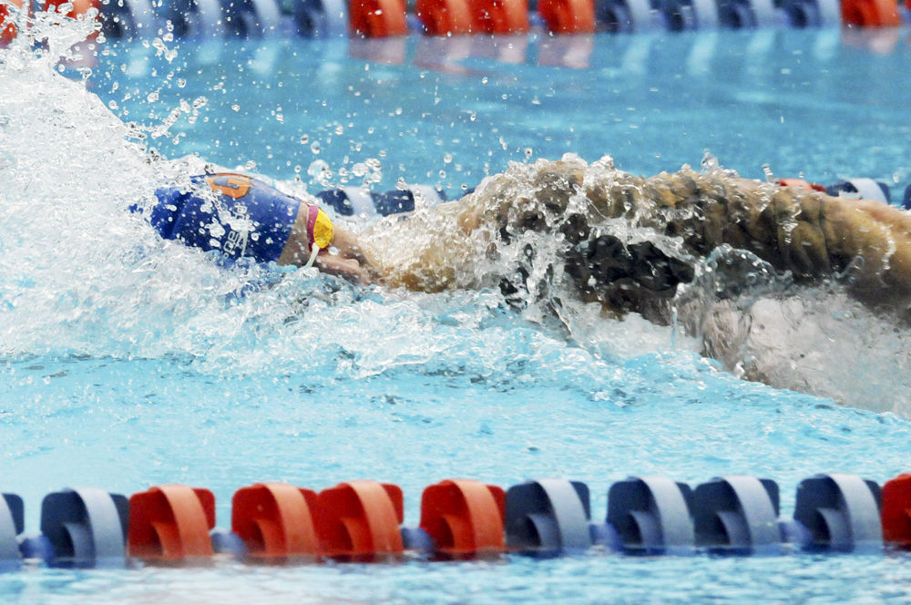 Caeleb Dressel races in the 400 meter freestyle relay during Florida's meet against Auburn on Jan. 23, 2016, in the O'Connell Center.     Alligator File Photo