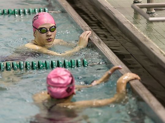 Emily Weiss chats with a teammate between exercises during swim practice at Yorktown High School, Yorktown, Ind., Wednesday, Nov. 1, 2017. Last season, Weiss beat Lilly King's Indiana state record, completing the 100 meter breaststroke in 59.37 seconds. (Photo: Jenna Watson/IndyStar)