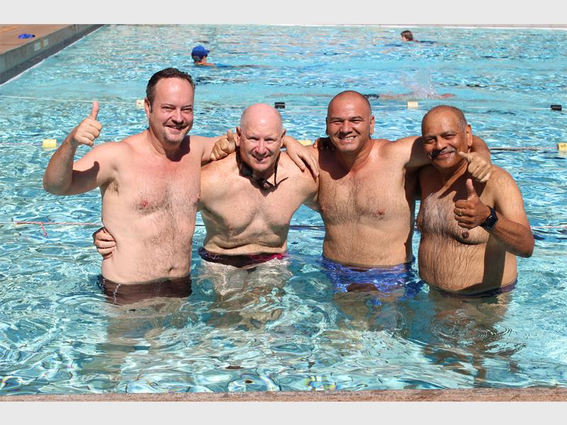 Community Chest's Gordon McDonald, with swimmers Stuart Dubber, Shane Khan and Heren Ramawtar. (Bera Mail)
